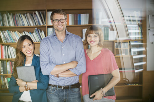 Business people smiling in office - CAIF14946