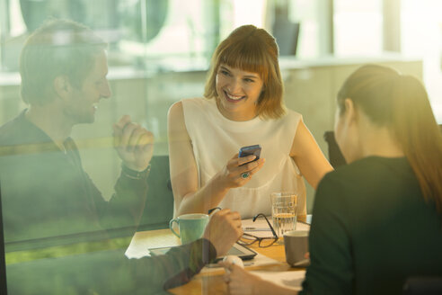 Business people talking in office meeting - CAIF14958