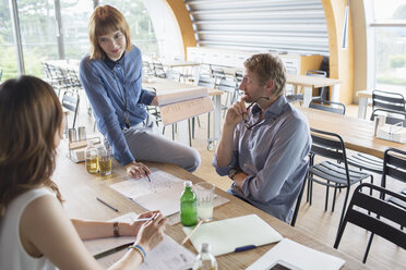 Business people talking in meeting in cafeteria - CAIF14964