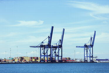 Cranes and cargo containers at waterfront - CAIF15135