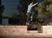 Side view of man jumping with skateboard at night - CAVF06268