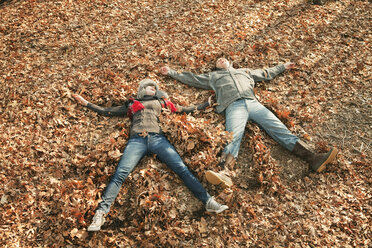 High angle view of couple lying on field - CAVF06364