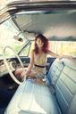 Portrait of woman sitting in vintage car - CAVF06445