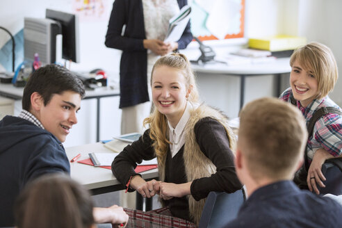 High School students sitting and smiling in classroom - CAIF15211