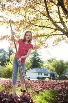 Portrait of girl sweeping in backyard - CAVF06772