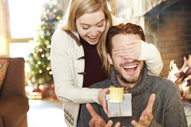 Couple exchanging gifts on Christmas - CAIF15391