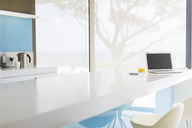View of modern kitchen with laptop on kitchen counter - CAIF15529