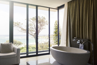 Luxurious bathroom with beautiful view on coast - CAIF15544