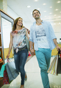 Couple shopping together in store - CAIF15577