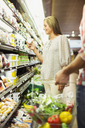Couple shopping together in grocery store - CAIF15610