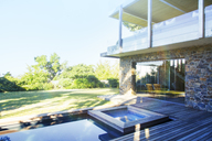 Modern house overlooking pool and wooden deck - CAIF15640