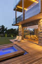 Modern house overlooking swimming pool and wooden deck - CAIF15643