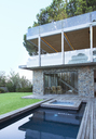 Modern house overlooking swimming pool and wooden deck - CAIF15646
