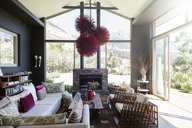 Living room with fireplace and modern chandelier - CAIF15685