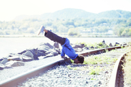 Man exercising on railroad track - CAVF07748