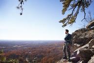 Man standing on rocks against sky - CAVF07802