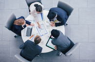 Business people talking in meeting at table - CAIF15748