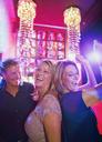 Women and man dancing in nightclub - CAIF15832