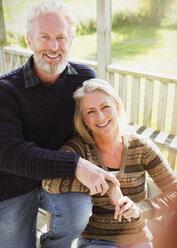 Portrait smiling senior couple on porch - CAIF15874