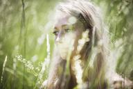 Woman in field looking away - CAVF08081