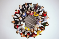Portrait of confident business people in circle - CAIF16201