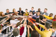 Business people connecting hands in huddle - CAIF16219