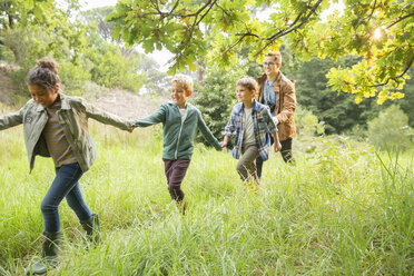 Students and teacher walking outdoors - CAIF16240