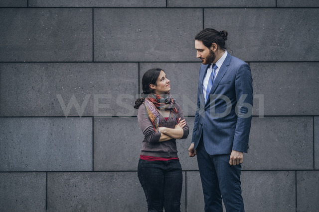 Businessman and woman looking at each other - JSCF00094