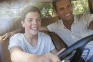 Father teaching son to drive - CAIF16704