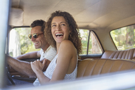 Couple laughing during car ride - CAIF16722