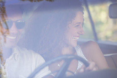 Couple enjoying car ride together on sunny day - CAIF16752