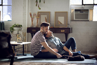 Gay couple relaxing at home - CAVF08392