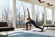 Man practicing yoga at home - CAVF08560