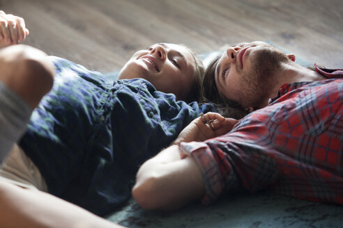 Couple lying on floor at home - CAVF08584