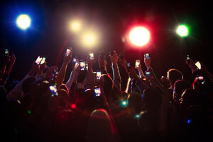 Audience using camera phones at concert - CAIF16778