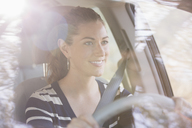 Smiling woman driving car - CAIF16964