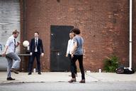 Friends playing soccer on street - CAVF09052