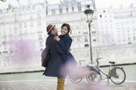Couple hugging along Seine River, Paris, France - CAIF17028