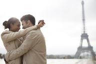 Couple hugging near Eiffel Tower, Paris, France - CAIF17031