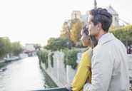 Couple looking at Seine River, Paris, France - CAIF17052