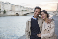 Couple walking along Seine River, Paris, France - CAIF17061