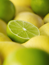 Extreme close up of sliced lime among lemons - CAIF17079
