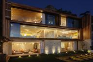 Modern house illuminated at night - CAIF17085