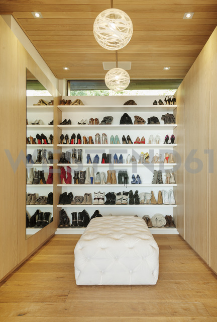 Modern walk-in closet with shoes on shelves - CAIF17106