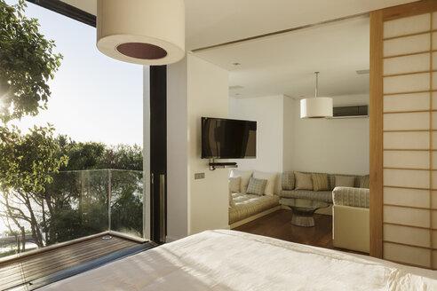 Sunny bedroom with balcony - CAIF17124
