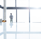 Businessman standing at office window - CAIF17127