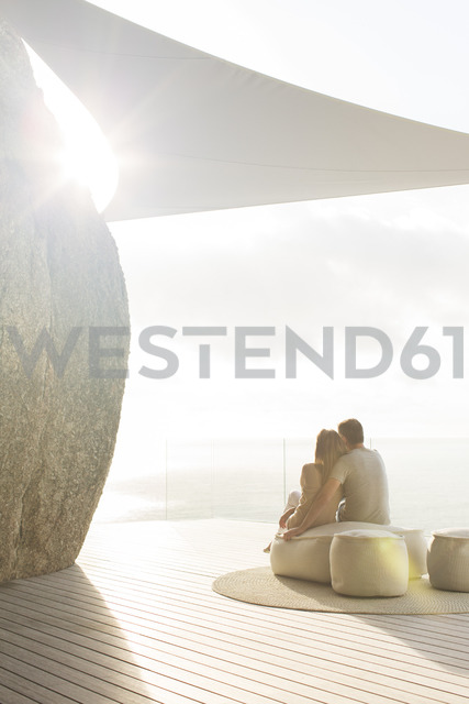 Couple relaxing together on modern balcony - CAIF17154 - Astronaut Images/Westend61