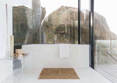 Bathtub and glass walls in modern bathroom - CAIF17175