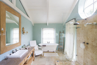 Bathtub and shower in rustic bathroom - CAIF17190