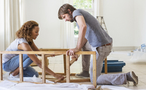 Couple building furniture together - CAIF17227